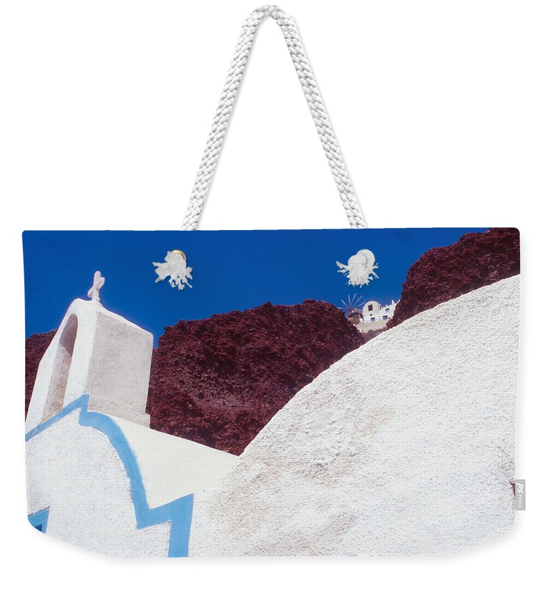 Greece Weekender Tote Bag featuring the photograph Church And Windmill In Santorini Greece by Yuri Lev