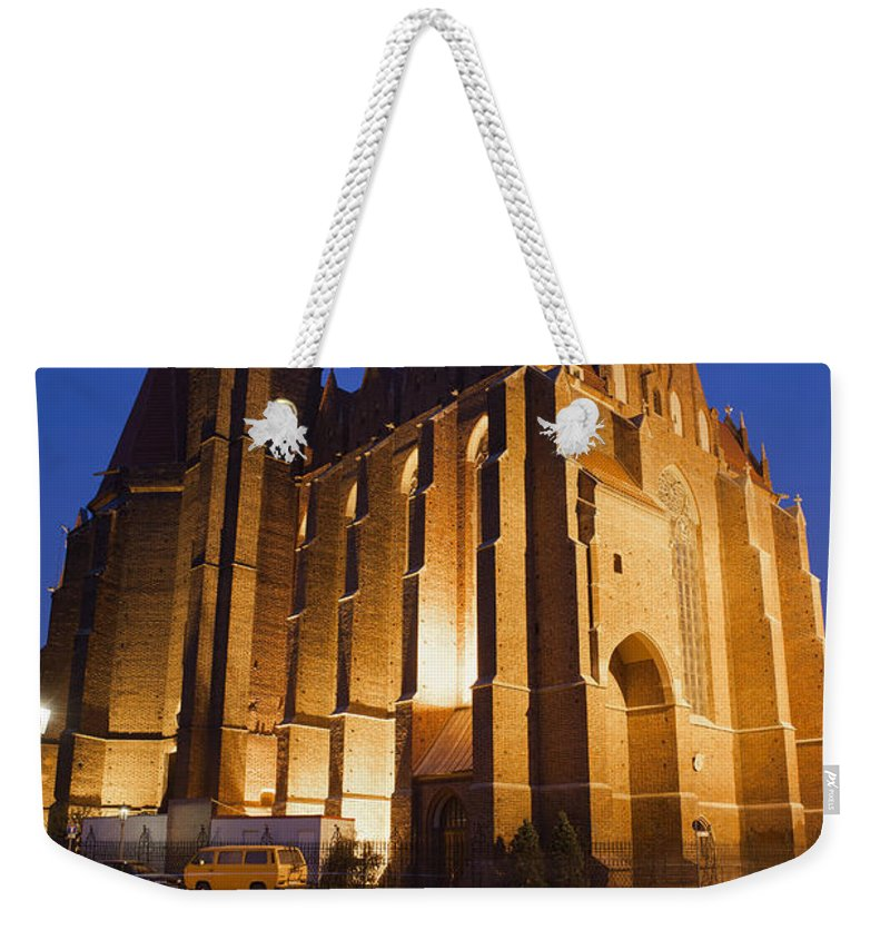 Wroclaw Weekender Tote Bag featuring the photograph Church Of The Holy Cross By Night In Wroclaw by Artur Bogacki