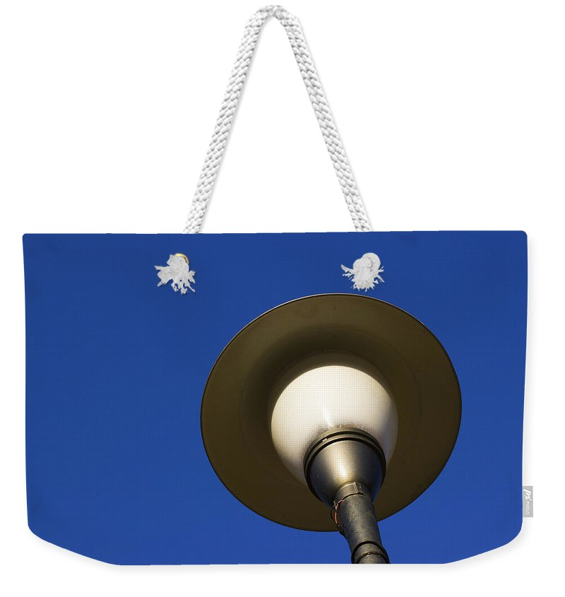 Minimal Weekender Tote Bag featuring the photograph Circle And Blues by Prakash Ghai