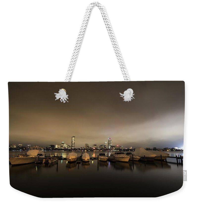 Boston Weekender Tote Bag featuring the photograph Citgo Sign Through The Boats On The Charles River Boston Ma Massachusetts Wide Angle by Toby McGuire