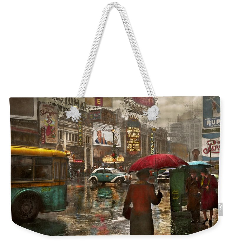 New York Weekender Tote Bag featuring the photograph City - Ny - Times Square On A Rainy Day 1943 by Mike Savad