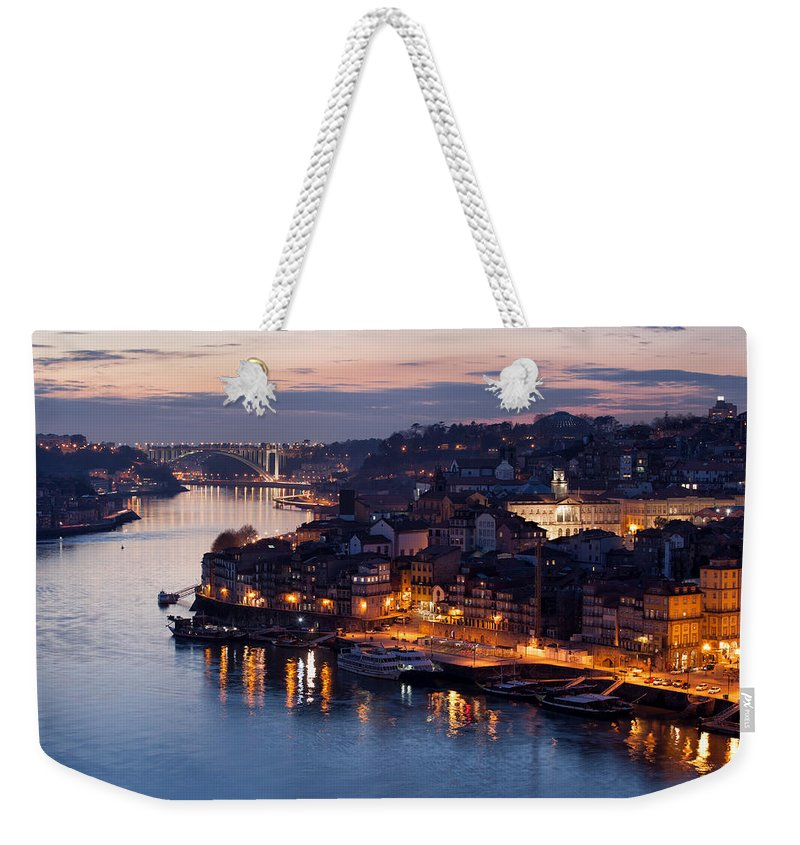 Porto Weekender Tote Bag featuring the photograph City Of Porto In Portugal At Dusk by Artur Bogacki