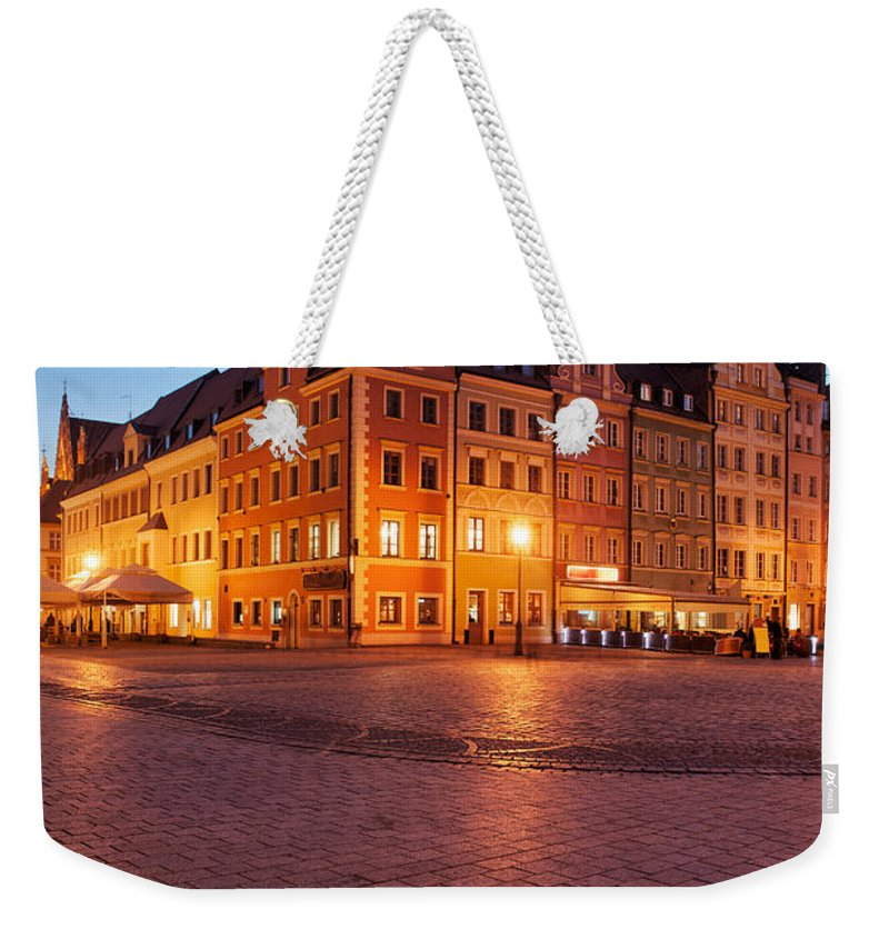 Wroclaw Weekender Tote Bag featuring the photograph City Of Wroclaw Old Town Market Square At Night by Artur Bogacki