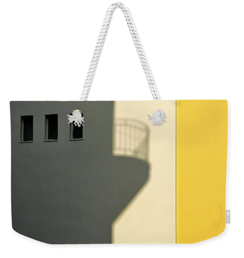 City Weekender Tote Bag featuring the photograph City Shadow by Silvia Ganora