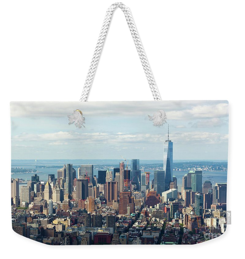 New Weekender Tote Bag featuring the photograph Cityscape View Of Manhattan, New York City. by Antonio Gravante