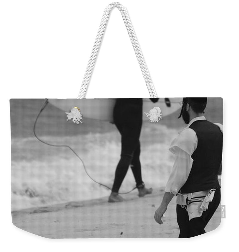 Black And White Weekender Tote Bag featuring the photograph Clash Of Cultures by Rob Hans