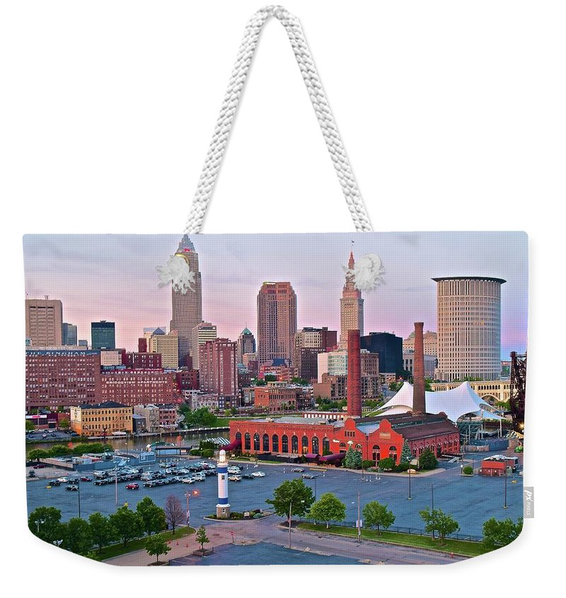 Cleveland Weekender Tote Bag featuring the photograph Cle Sunset View From The Shoreway by Frozen in Time Fine Art Photography