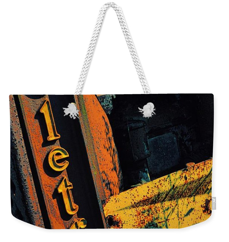 Cletrac Weekender Tote Bag featuring the photograph Cletrac Crawler Tractor by Michelle Calkins