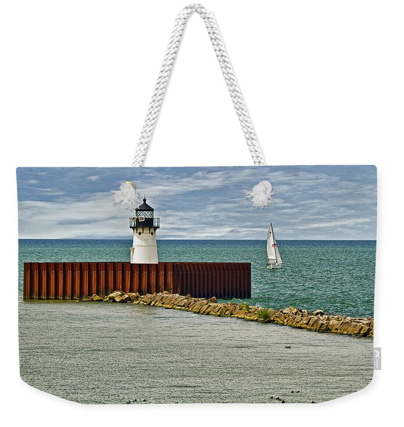 Architecture Weekender Tote Bag featuring the photograph Cleveland Harbor Small Lighthouse by Marcia Colelli