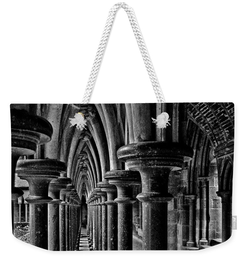 Arches Weekender Tote Bag featuring the photograph Cloister Colonnade by Nikolyn McDonald