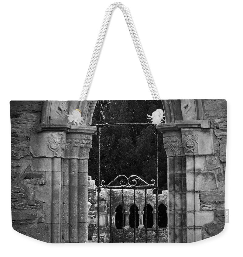Irish Weekender Tote Bag featuring the photograph Cloister View Cong Abbey Cong Ireland by Teresa Mucha