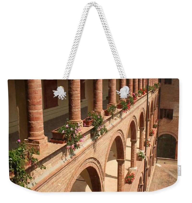 Courtyard Weekender Tote Bag featuring the photograph Cloistered Courtyard by Christiane Schulze Art And Photography