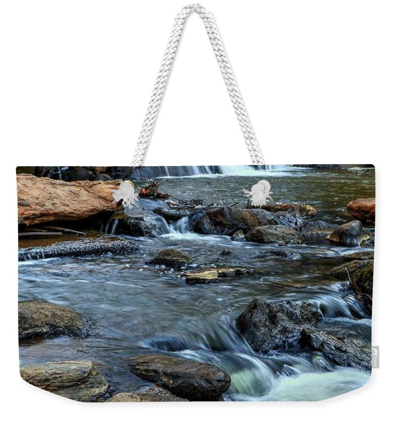 Falls Park On The Reedy River Weekender Tote Bag featuring the photograph Close Up Of Reedy Falls In South Carolina by Carol Montoya