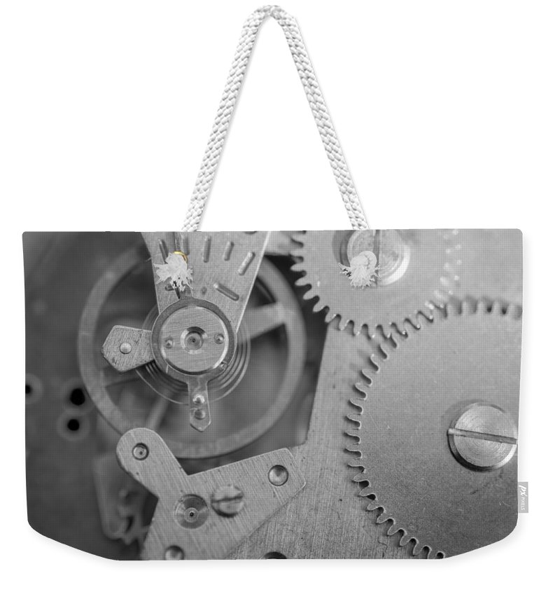 Ancient Weekender Tote Bag featuring the photograph Closeup Macro Of Clock Mechanism by John Williams