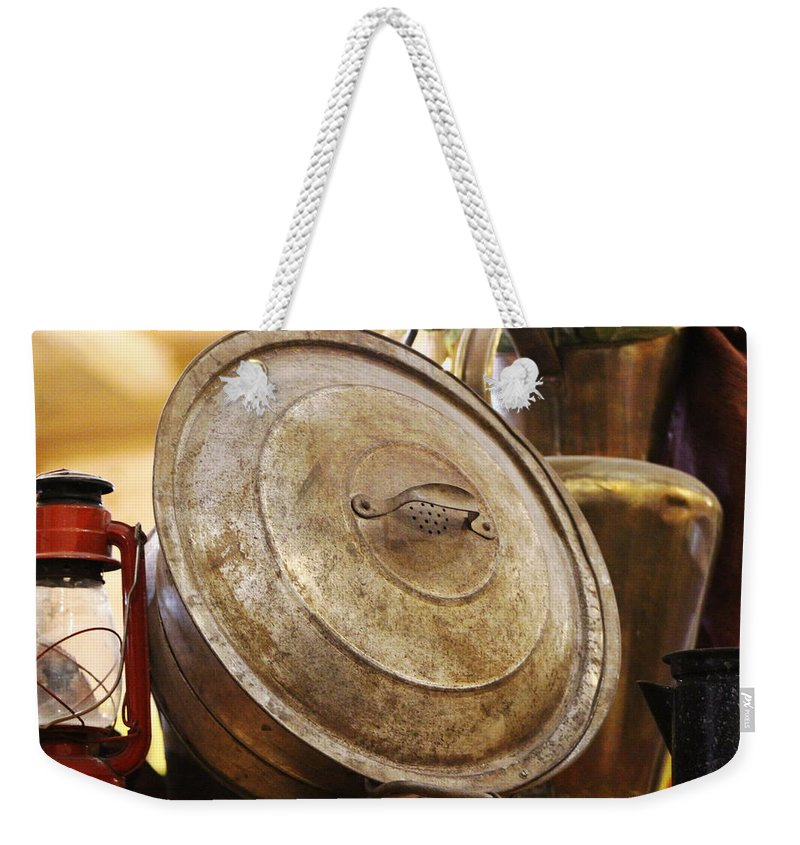 Hurricane Lamp Weekender Tote Bag featuring the photograph Closeup of Antique Pot and Hurricane Lantern by Colleen Cornelius