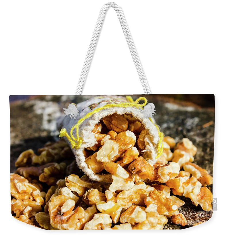 Nut Weekender Tote Bag featuring the photograph Closeup Of Walnuts Spilling From Small Bag by Jorgo Photography - Wall Art Gallery