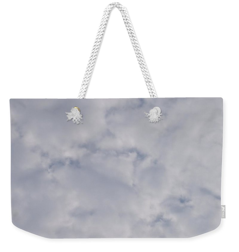 Clouds Weekender Tote Bag featuring the photograph Cloud Mass - Fist Holding Arrowhead - Look Closely by Deborah Crew-Johnson