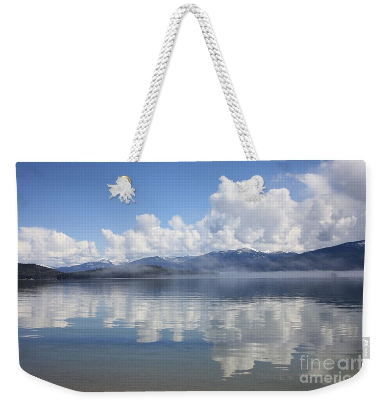Clouds Weekender Tote Bag featuring the photograph Cloud Reflection On Priest Lake by Carol Groenen