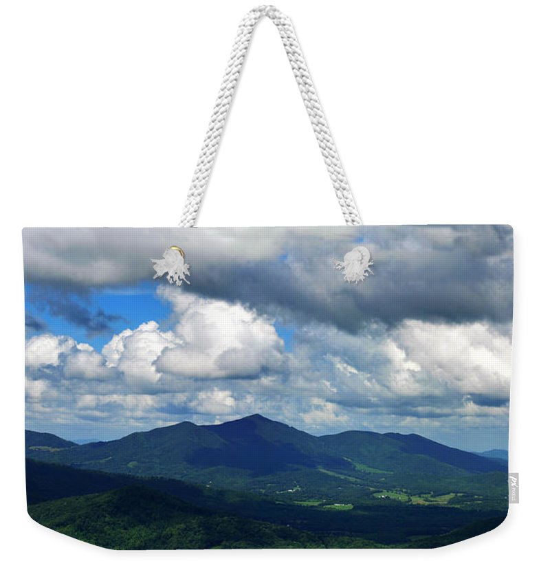 Clouds Weekender Tote Bag featuring the photograph Clouded Landscape by Eric Liller