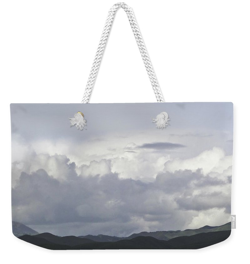 Landscape Weekender Tote Bag featuring the photograph Clouds by Karen W Meyer