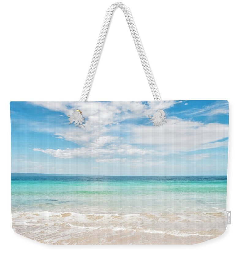 Kangaroo Island Weekender Tote Bag featuring the photograph Clouds Over Blue Sea by Catherine Reading