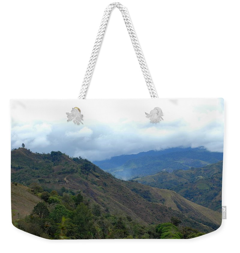 Tropics Weekender Tote Bag featuring the photograph Clouds Over The Mountains by Teresa Stallings