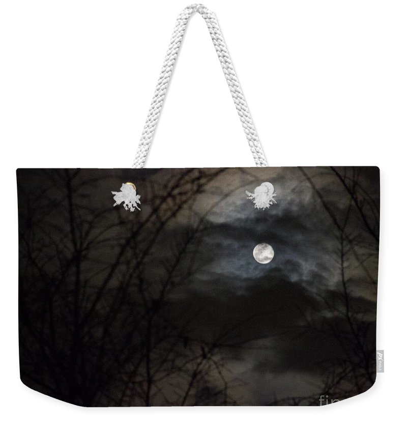 Snow Moon Weekender Tote Bag featuring the photograph Clouds Passing The Snow Moon by Rebecca Pavelka