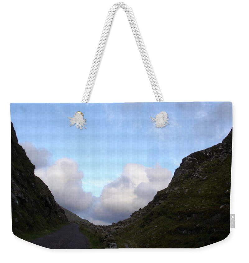 Weekender Tote Bag featuring the photograph Clowdy Drive by Kelly Mezzapelle
