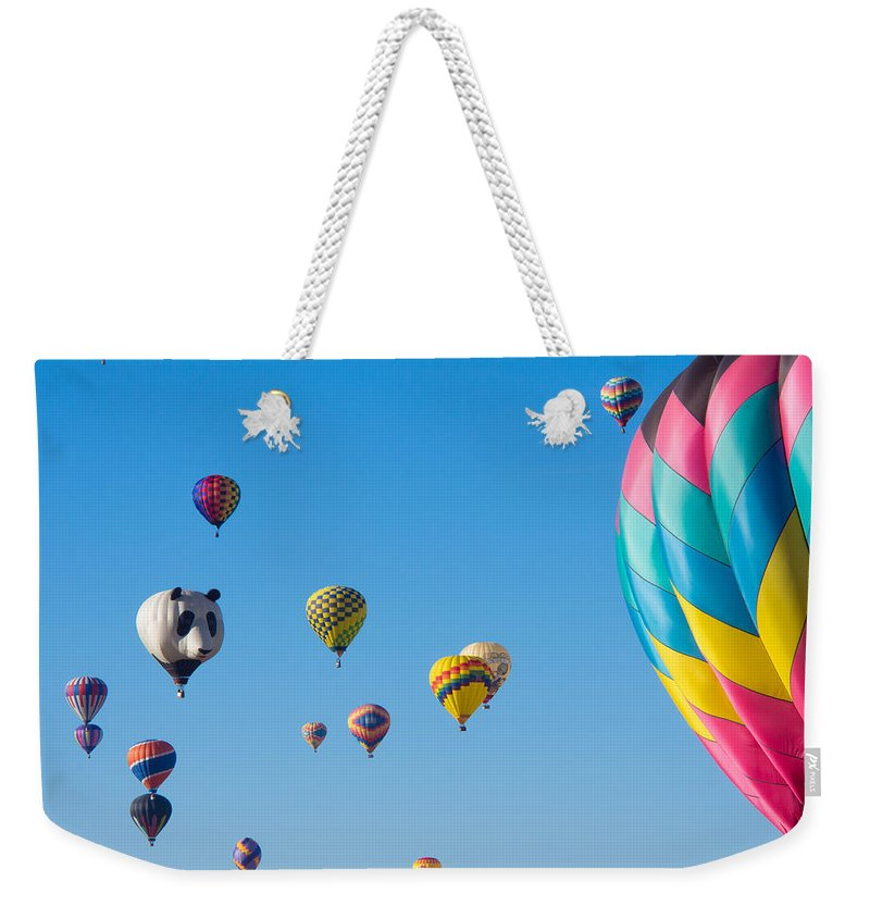 Balloon Fiesta Weekender Tote Bag featuring the photograph Cluttered Sky by Dan Leffel