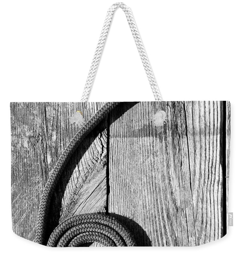 Coiled Weekender Tote Bag featuring the photograph Coiled by Charles Harden