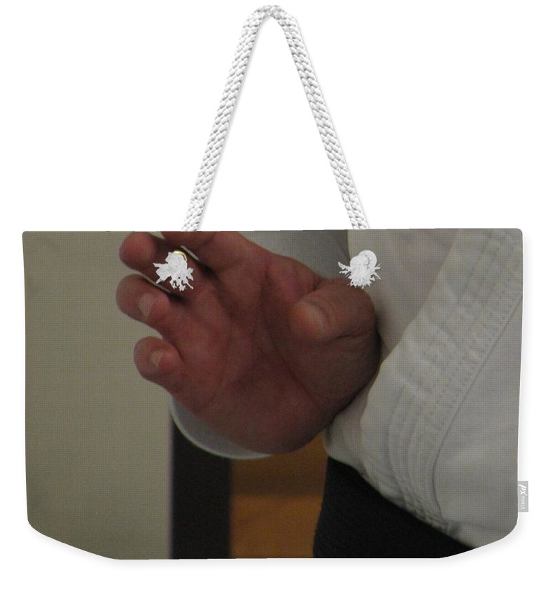 Karate Weekender Tote Bag featuring the photograph Coiled by Kelly Mezzapelle