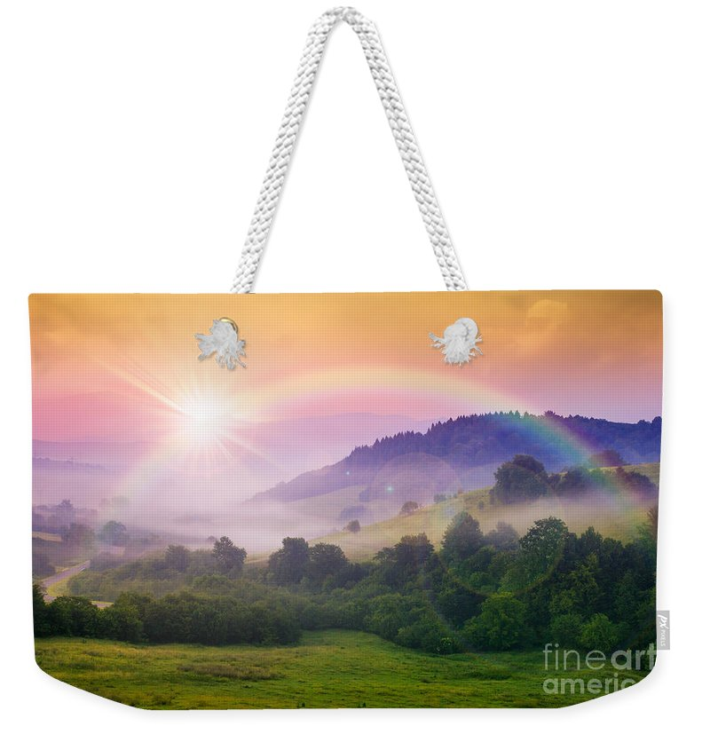 Landscape Weekender Tote Bag featuring the photograph Cold Fog On Hot Sunrise In Mountains by Michael Pelin
