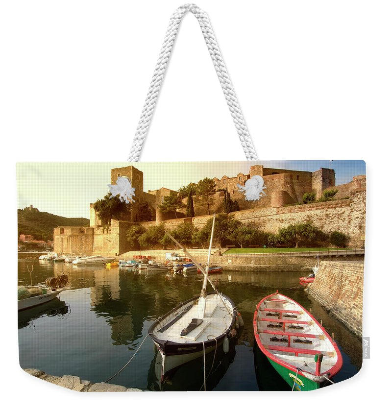 Weekender Tote Bag featuring the photograph Collioure Castle by Robert Stein
