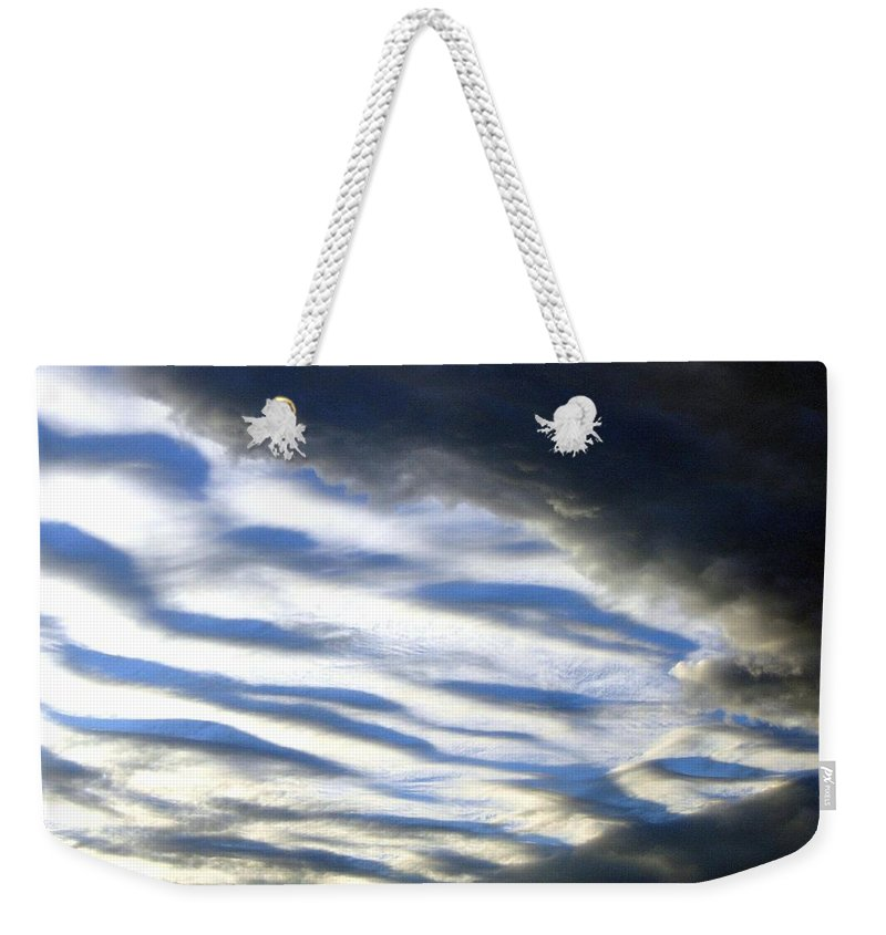 Storm Clouds Weekender Tote Bag featuring the photograph Collision by Will Borden