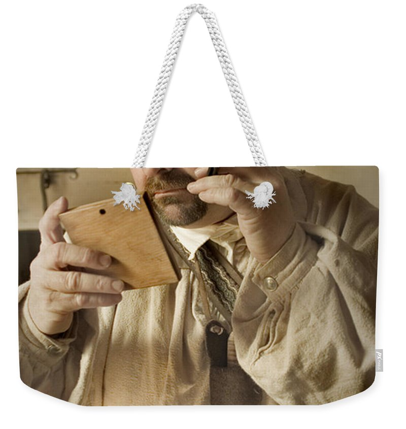 Primitive Weekender Tote Bag featuring the photograph Colonial Man Shaving by Kim Henderson