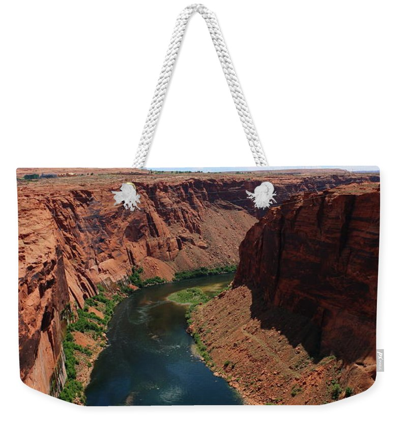 River Weekender Tote Bag featuring the photograph Colorado River At Glen Canyon Dam by Christiane Schulze Art And Photography
