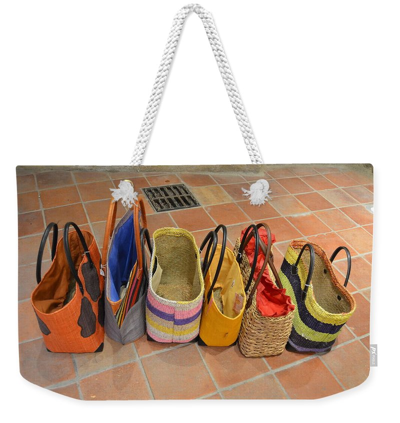 Colorful Weekender Tote Bag featuring the photograph Colorful Purses by Dawn Crichton