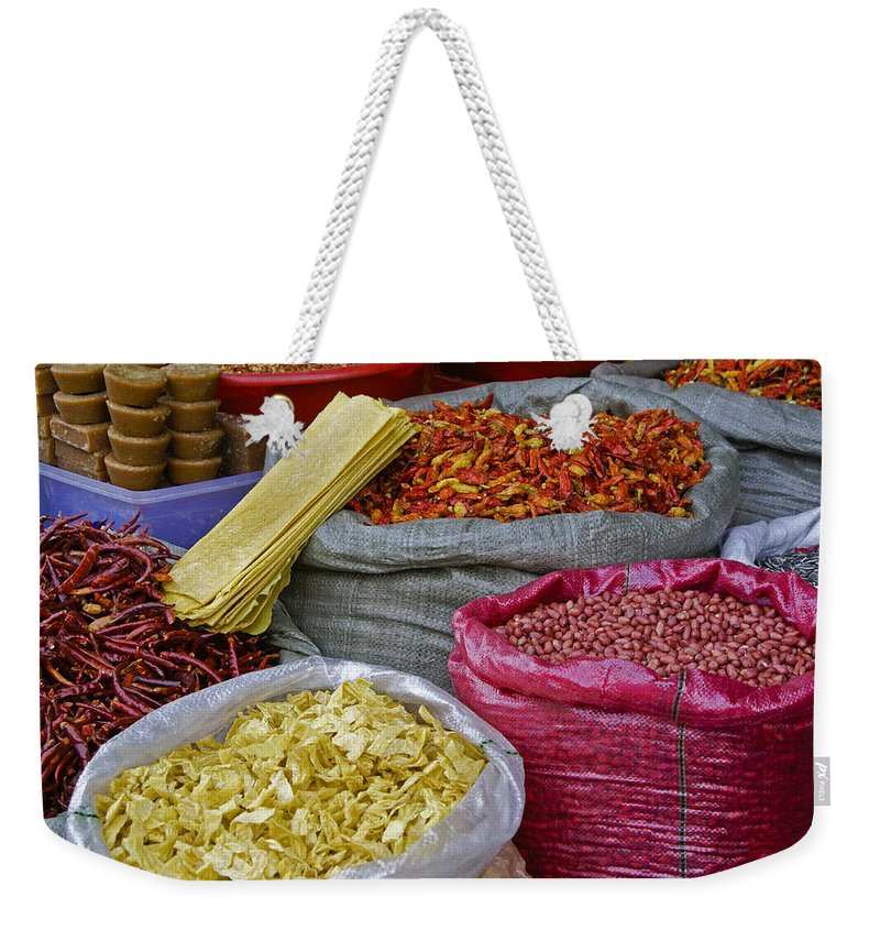 Asia Weekender Tote Bag featuring the photograph Colors In A Chinese Market by Michele Burgess