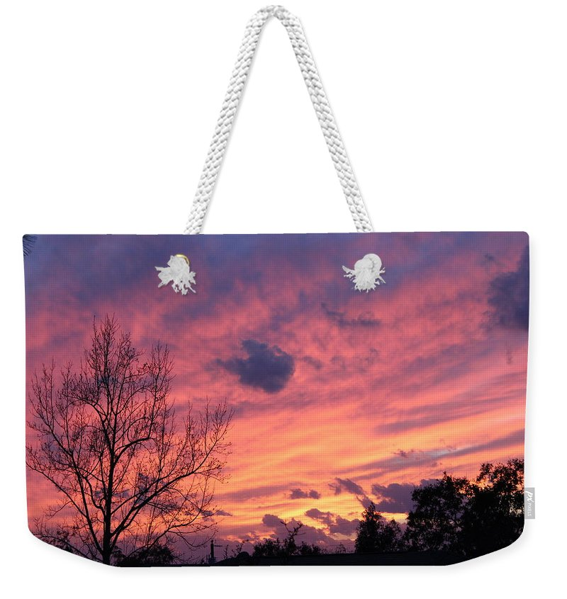 Sky Weekender Tote Bag featuring the photograph Colors Of Sunset by Jonathan Morgan