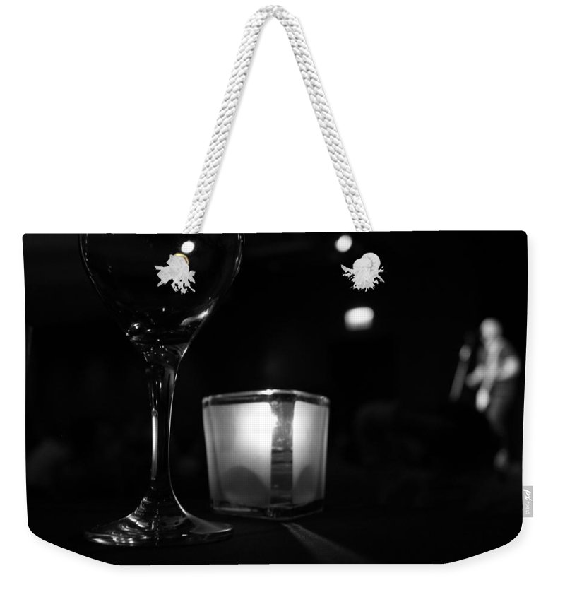 Candle Weekender Tote Bag featuring the photograph Concert Ambiance by Lauri Novak