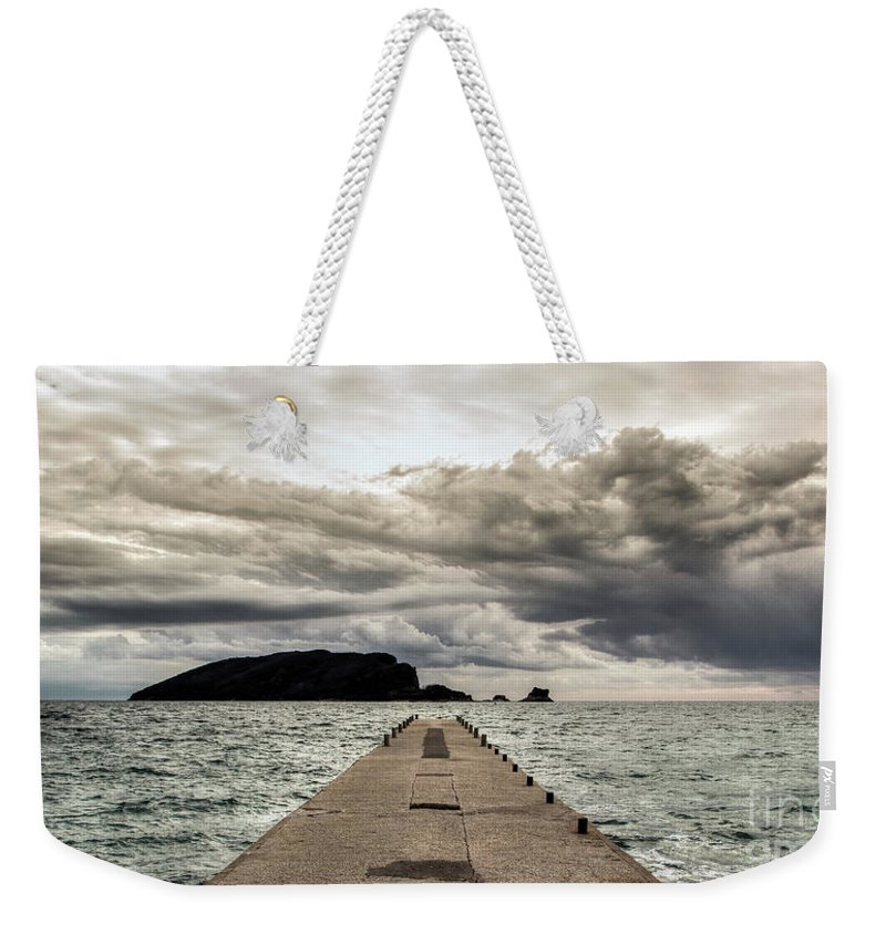 Adriatic Weekender Tote Bag featuring the photograph Concrete Pier Off-season by Bratislav Stefanovic