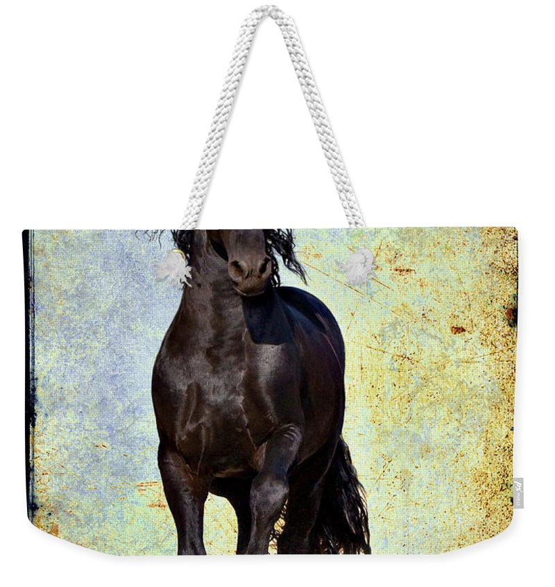 Weekender Tote Bag featuring the photograph Conqueror by Jean Hildebrant