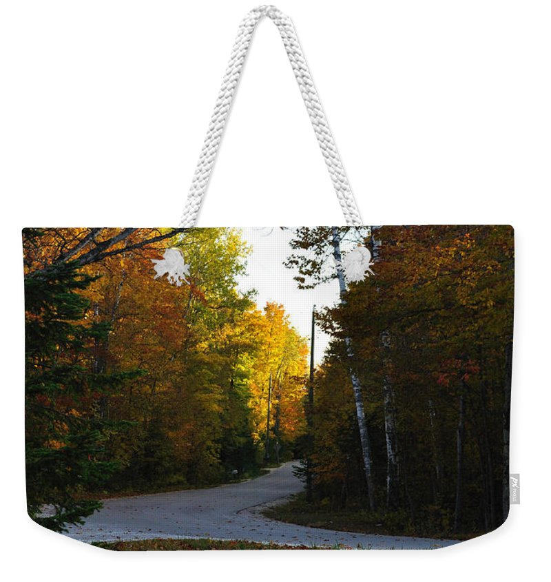 Fall Weekender Tote Bag featuring the photograph Convergence by Tim Nyberg
