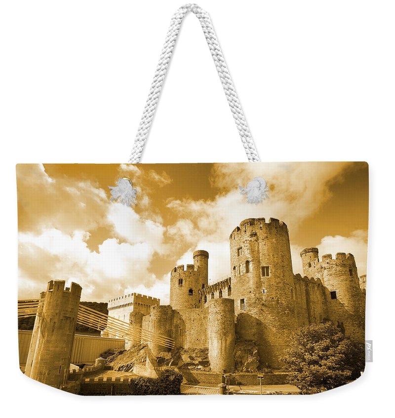 Castle Weekender Tote Bag featuring the photograph Conwy Castle And The Telford Suspension Bridge North Wales by Mal Bray