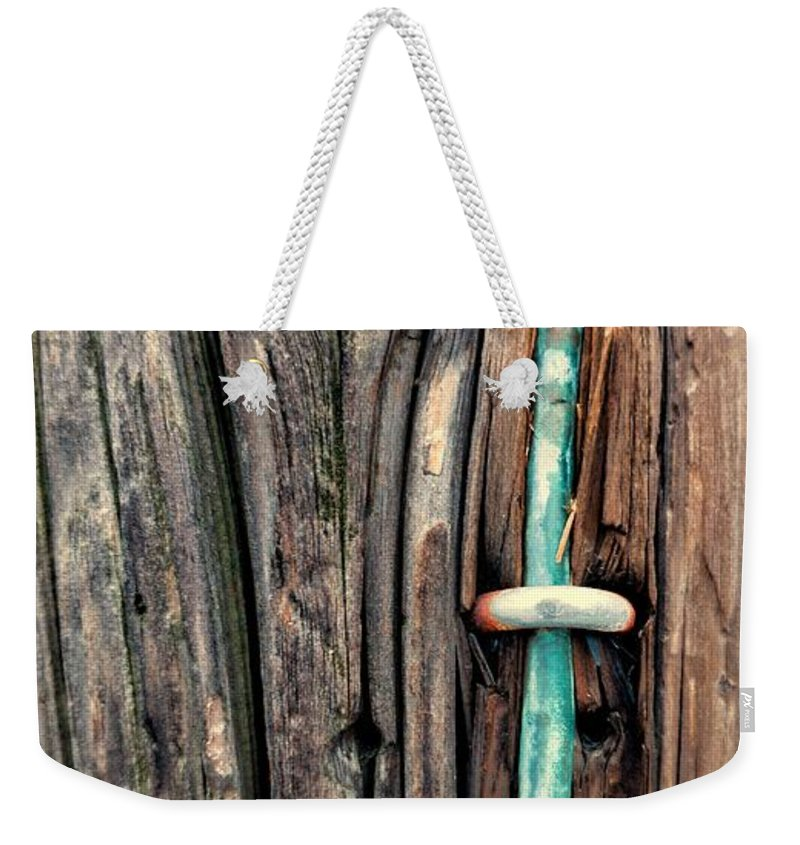 Weekender Tote Bag featuring the photograph Copper Ground Wire And Knothole On Utility Pole by Chester Wiker