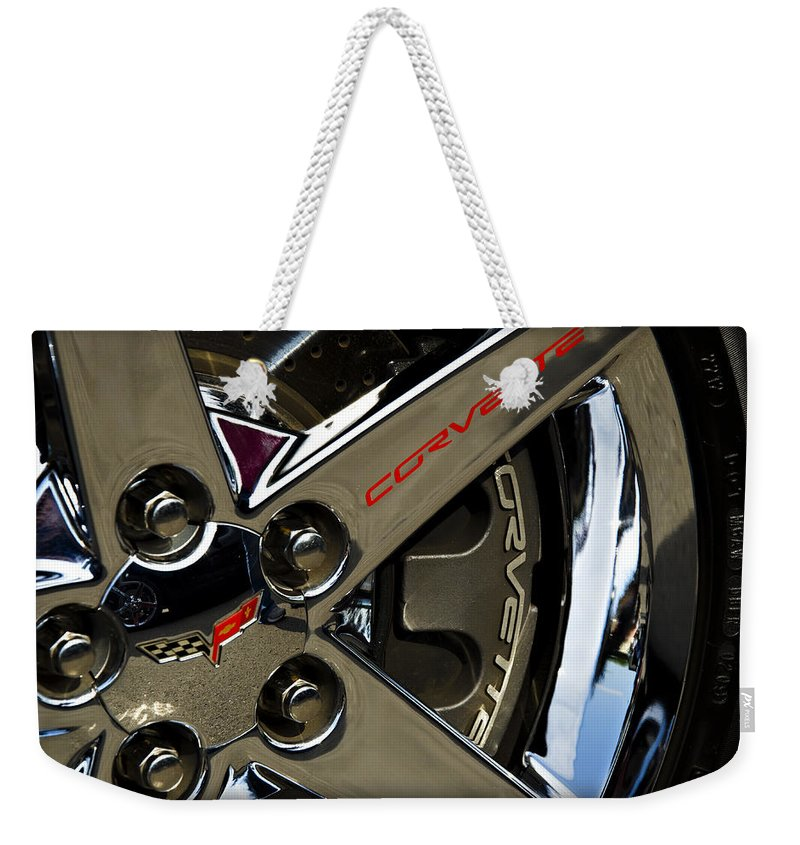Corvette Weekender Tote Bag featuring the photograph Corvette Spokes II by Ricky Barnard