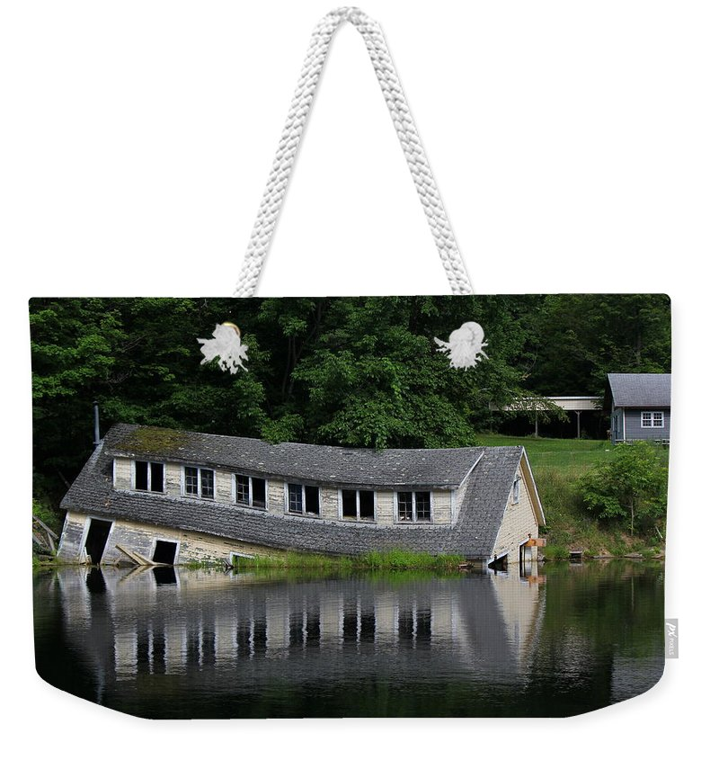 Cottage Weekender Tote Bag featuring the photograph Cottage Sinking In The Rideau Canal by Qingrui Zhang