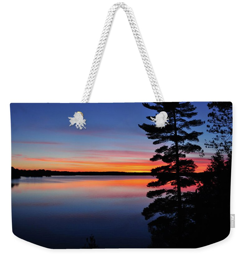 Lake Weekender Tote Bag featuring the photograph Cottage Sunset by Keith Armstrong