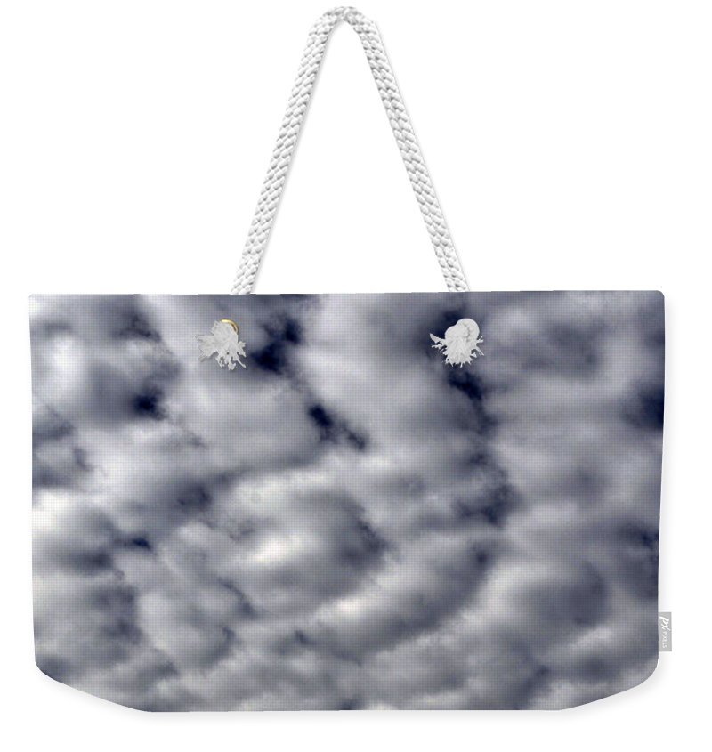 Clay Weekender Tote Bag featuring the photograph Cotton Clouds by Clayton Bruster