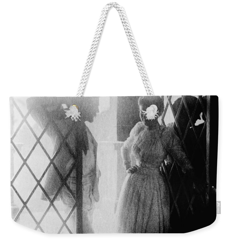 19th Century Weekender Tote Bag featuring the photograph Couple In Doorway by Granger